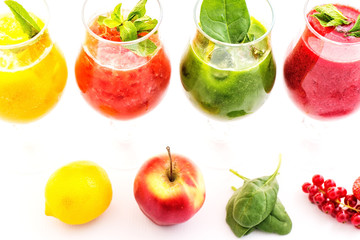 healthy colorful smoothies with fresh fruits isolated on white background. Detox and diet food concept and background