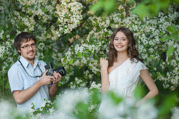The man photographs and young girl in a garden