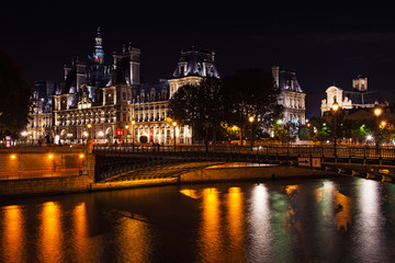 Stunning night view of Hotel de Ville in Paris, France.
