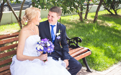 Nice young wedding couple outdoors