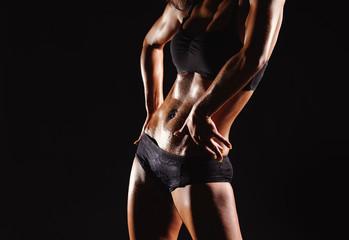 Beautiful female body on a dark background