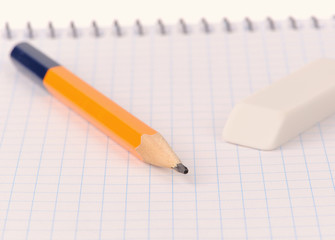Notepad with pencil and eraser