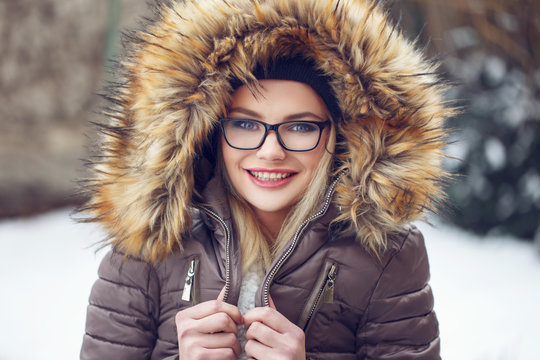 Woman shiver outdoor at winter in glasses