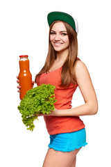 Happy teen girl holding a bottle of carrot juice