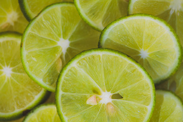 Lime slices background in green