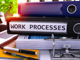 Work Processes - Black Ring Binder on Office Desktop with Office Supplies and Modern Laptop. Work Processes Business Concept on Blurred Background. Work Processes - Toned Illustration. 3D Render.