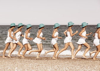Woman running on the beach. Multiple exposure shot.