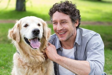 Smiling man with his dog in park