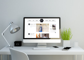 modern clean workspace with fashion celebrity website on screen