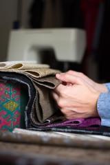 Closeup of a woman using a sewing machine