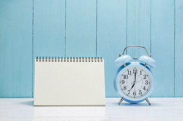 Blank desk calender with vintage Alarm clock