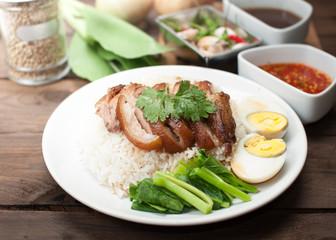 Thai stewed pork leg with rice on wood(Kao Kha Moo)