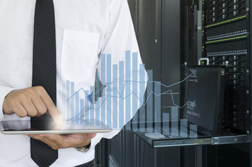 Business man use tablet for analyze in data center
