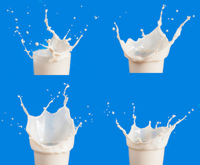 Set of Splash of milk from the glass on a blue background