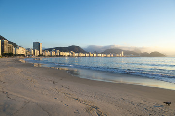 Tranquil sunrise view of Copacabana Beach on a clear clear morning in Rio de Janeiro Brazil