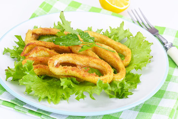 Fried Squid Rings in Breadcrumbs with Lettuce and Lemon