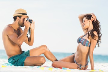 Boyfriend taking picture of girlfriend