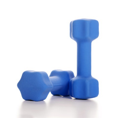 Fitness concept with two blue dumbbells on white background