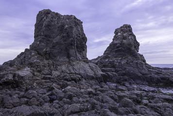 Towering rocks at low tide