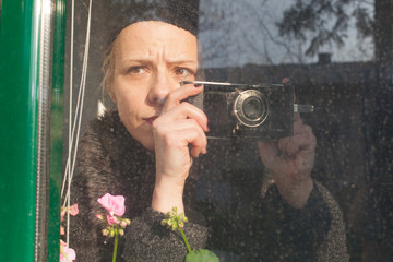 portrait of a woman with camera