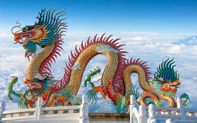 Colorful dragon statue with blue sky and clouds on heaven