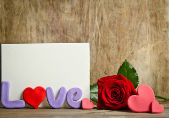 Word Love composition with empty card for text on the wooden boa