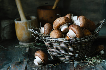 Brown mushrooms in a basket