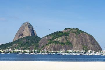 Classic daytime scenic profile view of Pao de Acucar Sugarloaf Mountain in Rio de Janeiro, Brazil standing above Botafogo Bay