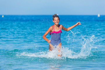 Girl running through the water