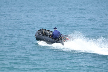 inflatable boat on the ocean (Back side - Selective focus)