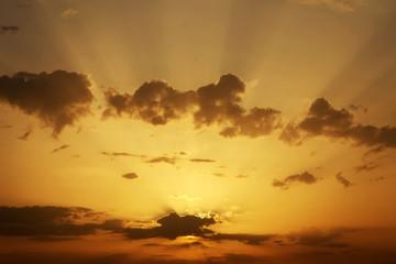 Beautiful Sunset with sun rays. Sunset sky background