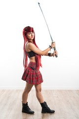 Young redhead girl with katana