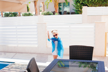 Beautiful girl in sunglasses outdoor under the sun