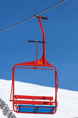 red chair of ski lift