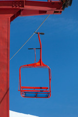 one red chair of ski lift