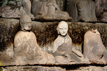 Ancient carving of a Buddas on the side of Mount Nokogiri.