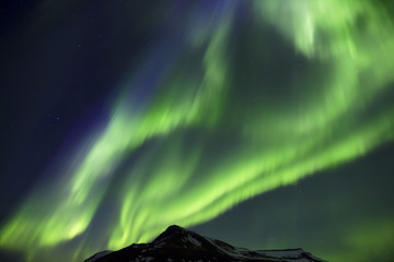 Northern Lights above mountains edge