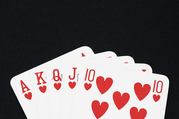 Playing card on black table, Straight flush