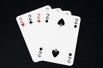 Playing card on black table, four of a kind cards