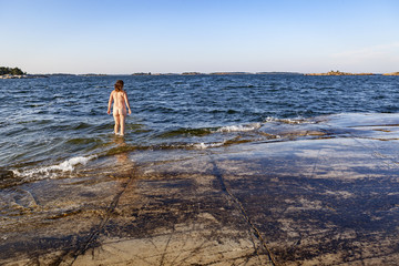 Naked young woman in sea