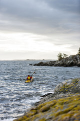 Person kayaking on sea