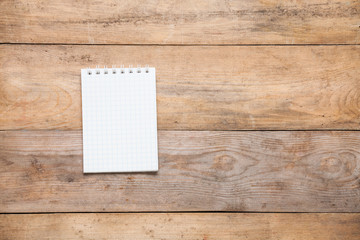 Blank notebook on wooden background. Copy space.