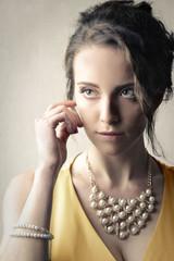 Elegant lady wearing pearls