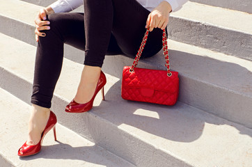 Wall Mural - Fashion woman with red high heel shoes and handbag