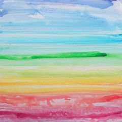 Abstract watercolor rainbow gradient background.
