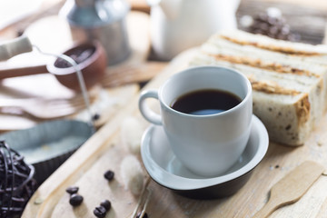 Close up of coffee cup and freshly baked bread