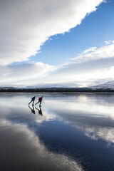 Two people moving on ice