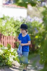 Boy exploring garden