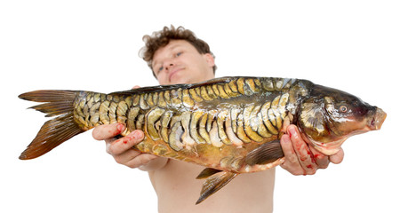 carp in male hands on a white background