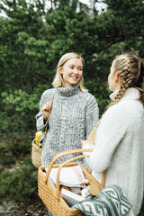 Smiling young women standing in forest